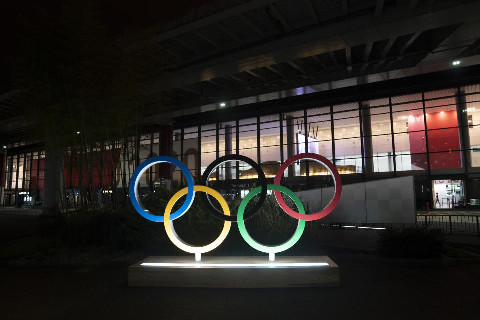 FILE - In this Saturday, July 10, 2021, file photo, the Olympic rings are illuminated outside the Narita International Airport prior to the 2020 Summer Olympics near Tokyo. The Olympic corporate sponsorship program has been a key part of the Olympic experience since it began in 1985. But all that magic from the Olympic sponsorship is being undermined because of the virus. (AP Photo/Jae C. Hong, File)