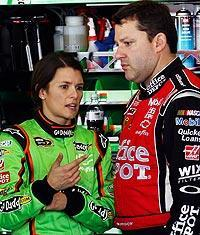 Danica Patrick chats with Tony Stewart in the garage at Daytona