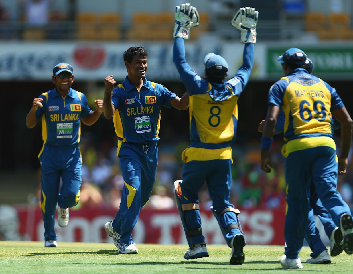 BRISBANE, AUSTRALIA - JANUARY 18:  Nuwan Kulasekara of Sri Lanka celebrates taking the wicket of George Bailey of Australia during game three of the Commonwealth Bank One Day International Series between Australia and Sri Lanka at The Gabba on January 18, 2013 in Brisbane, Australia.  (Photo by Robert Cianflone/Getty Images)