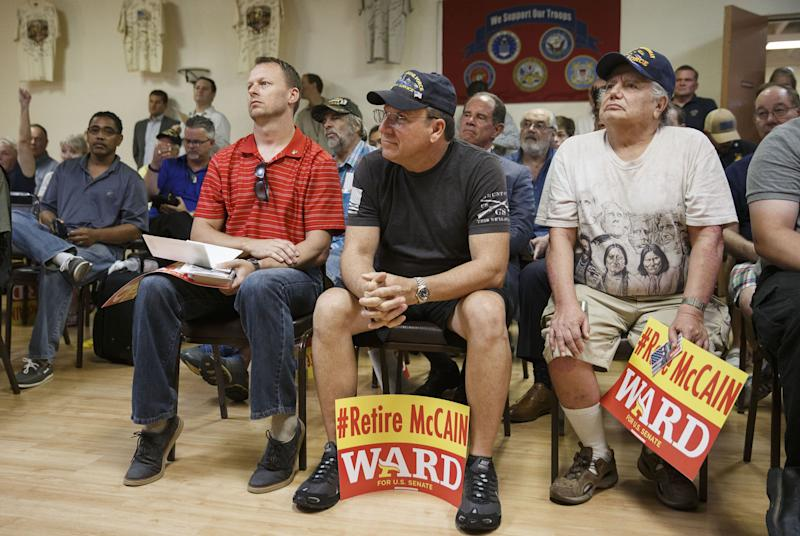 Veterans listen as Kelli Ward speaks during a campaign stop at the Veterans of Foreign Wars Post 720 in Phoenixon Aug.11, 2016.