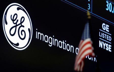 The ticker and logo for General Electric Co. is displayed on a screen at the post where it's traded on the floor of the New York Stock Exchange (NYSE) in New York City, U.S., June 30, 2016.  REUTERS/Brendan McDermid/Files