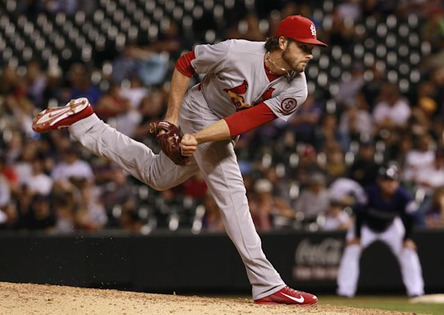 St. Louis Cardinals relief pitcher Kevin Siegrist works against the Colorado Rockies in the eighth inning of the Cardinals' 11-4 victory in a baseball game in Denver on Tuesday, Sept. 17, 2013. (AP Photo/David Zalubowski)