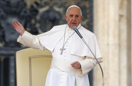Pope Francis talks as he leads the weekly audience in Saint Peter's Square at the Vatican