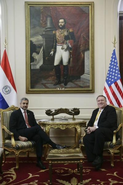"U.S. Secretary of State Mike Pompeo, right, listens to Paraguay's President Mario Abdo Benitez, during official meeting at ""Palacio de Lopez"", in Asuncion, Paraguay, Saturday, April 13, 2019. Pompeo is in the second of four countries' tour that includes Chile, Peru and Colombia to address, mainly, the crisis in Venezuela. On the wall is a paint of National Hero Marshal Francisco Solano Lopez. (AP Photo/Jorge Saenz)"
