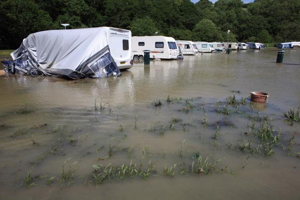 Caravans are damaged by flash floods at Riverside Caravan Park, near the village of Talybont on June 9, 2012 in Aberystwyth, Wales. Severe flooding has affected mid Wales with a major rescue operation under way taking to safety nearly 100 people so far. (Photo by Christopher Furlong/Getty Images)