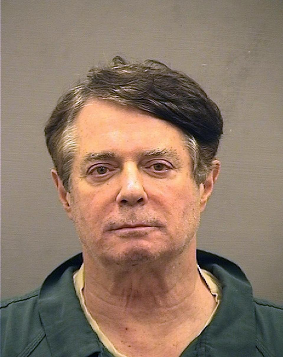 <p>In this handout provided by Alexandria Sheriff's Office, Paul Manafort poses for a mugshot photo at the Alexandria Detention Center in Alexandria, Va. Manafort has been charged with money laundering and bank fraud, among other violations. (Photo: Alexandria Sheriff's Office via Getty Images) </p>