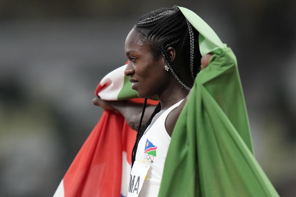 Christine Mboma, of Namibia, celebrates after her second place finish in the final of the women's 200-meters at the 2020 Summer Olympics, Tuesday, Aug. 3, 2021, in Tokyo. (AP Photo/Petr David Josek)