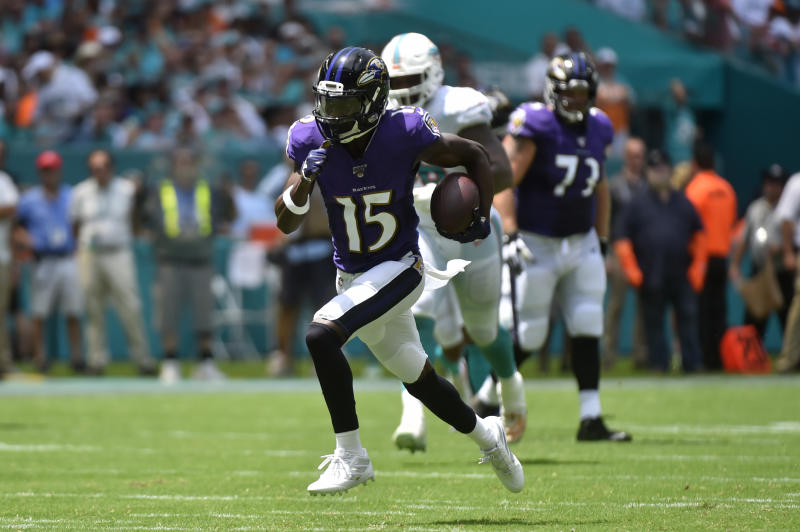 Marquise Brown #15 of the Baltimore Ravens catches a 47 yard touchdown pass from Lamar Jackson