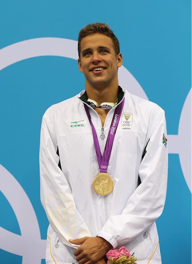 LONDON, ENGLAND - JULY 31: Gold medallist Chad le Clos of South Africa poses on the podium during the medal ceremony for the Men's 200m Butterfly final on Day 4 of the London 2012 Olympic Games at the Aquatics Centre on July 31, 2012 in London, England. (Photo by Clive Rose/Getty Images)