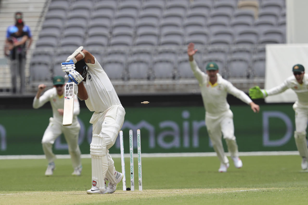 India's Murali Vijay is bowled by Australia's Mitchell Starc during play in the second cricket test between Australia and India in Perth, Australia, Saturday, Dec. 15, 2018. (AP Photo/Trevor Collens)