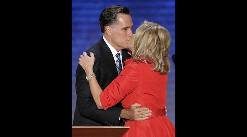 Ann Romney is kissed by her husband Republican presidential nominee Mitt Romney during the Republican National Convention in Tampa, Fla. on Tuesday, Aug. 28, 2012.  (AP Photo/J. Scott Applwhite)