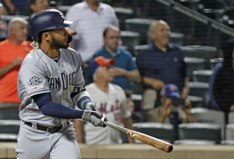 San Diego Padres' Fernando Tatis Jr. watches his RBI double to deep left center field during the ninth inning of a baseball game against the New York Mets, Tuesday, July 23, 2019, in New York. (AP Photo/Kathy Willens)