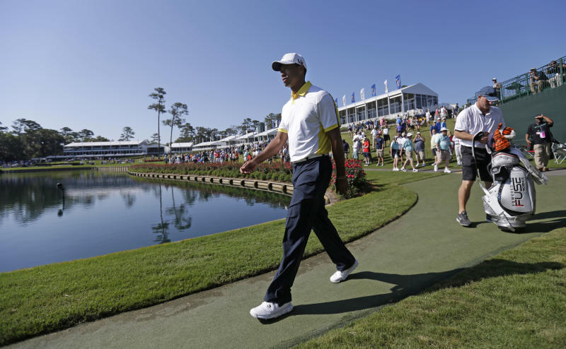 Tiger Woods walks to the 17th green during a practice round at The Players Championship golf tournament at TPC Sawgrass in Ponte Vedra Beach, Fla., Wednesday, May 8, 2013. (AP Photo/Gerald Herbert)