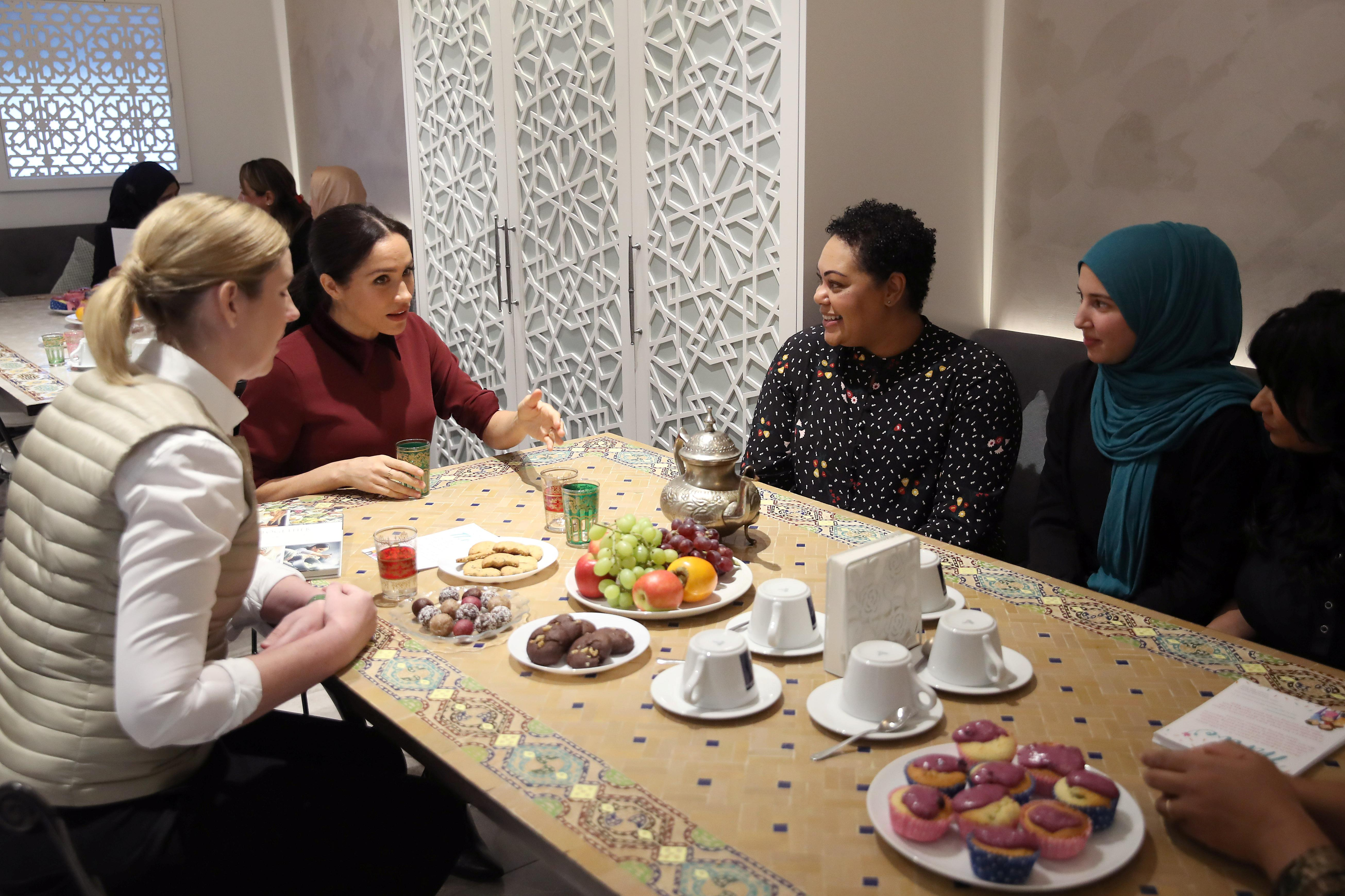 Britain's Meghan, Duchess of Sussex visits the Hubb Community Kitchen to see how funds raised by the 'Together: Our Community' cookbook are making a difference at Al Manaar, in London, Britain on November 21, 2018. Chris Jackson/Pool via REUTERS