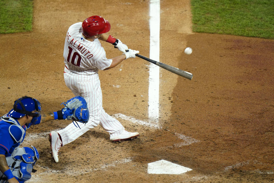Philadelphia Phillies' J.T. Realmuto hits a three-run home run off New York Mets pitcher Walker Lockett during the fifth inning of a baseball game, Friday, Aug. 14, 2020, in Philadelphia. (AP Photo/Matt Slocum)
