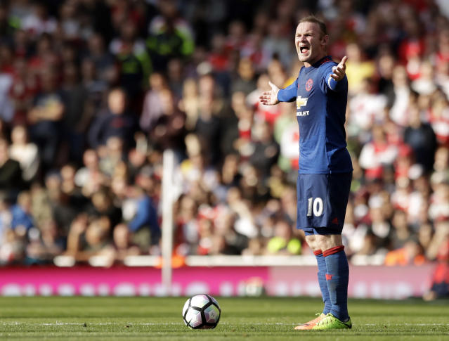 FILE - In this file photo dated Sunday, May 7, 2017, Manchester United's Wayne Rooney gestures during the English Premier League soccer match between Arsenal and Manchester United at the Emirates stadium in London. It is announced Tuesday Aug. 6, 2019, that 33-year old former England captain Wayne Rooney will be leaving US Major League Soccer team D.C. United to join second-tier English Championship team Derby County as player-coach from January 2020. (AP Photo/Matt Dunham, FILE)