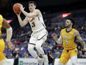 Loyola of Chicago's Clayton Custer (13) passes the ball as Valparaiso's Markus Golder (5) watches during the first half of an NCAA college basketball game in the quarterfinal round of the Missouri Valley Conference tournament, Friday, March 8, 2019, in St. Louis. (AP Photo/Jeff Roberson)