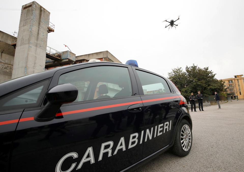 Carabinieri military police officers use a drone to monitor people who are not at home as Italy ramps up measures to try contain a spread of coronavirus disease (COVID-19), in the Scampia neighbourhood of Napes, Italy, March 25, 2020. REUTERS/Ciro De Luca