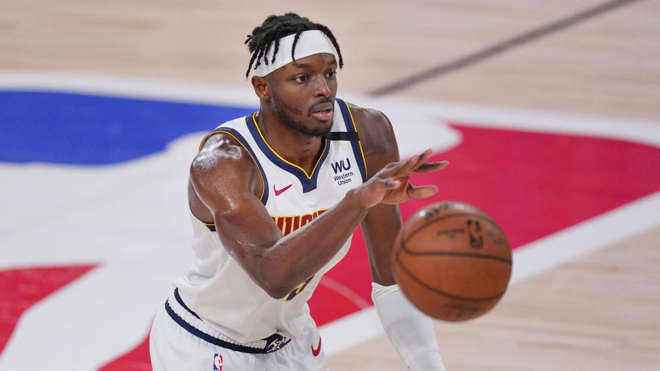 Denver Nuggets' Jerami Grant (9) plays against the Los Angeles Lakers during the first half of an NBA conference final playoff basketball game Saturday, Sept. 26, 2020, in Lake Buena Vista, Fla. (AP Photo/Mark J. Terrill)