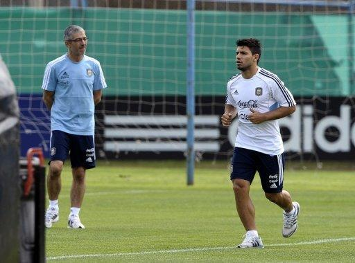 Sergio Aguero (R) jogs during a training session on September 8
