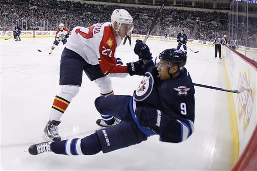 Florida Panthers' Nick Bjugstad (27) checks Winnipeg Jets' Evander Kane (9) during the second period of their NHL hockey game in Winnipeg, Manitoba, Thursday, April 11, 2013. (AP Photo/The Canadian Press, John Woods)