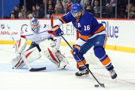 Dec 11, 2017; Brooklyn, NY, USA; New York Islanders left wing Andrew Ladd (16) plays the puck in front of Washington Capitals goalie Philipp Grubauer (31) during the second period at Barclays Center. Mandatory Credit: Brad Penner-USA TODAY Sports