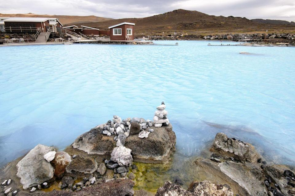 """<p>In the summer, Iceland is plenty warm enough for camping, and one excellent option is <a href=""""https://guidetoiceland.is/nature-info/the-ultimate-guide-to-lake-myvatn"""" rel=""""nofollow noopener"""" target=""""_blank"""" data-ylk=""""slk:Lake Myvatn"""" class=""""link rapid-noclick-resp"""">Lake Myvatn</a>. Iceland is a nature-lover's paradise, and Lake Myvatn is no exception. It is located in Northern Iceland and is one of the largest lakes in the country, boasting a beautiful hue and plenty to see all around it. Here you can see glacial canyons, lava formations, ice caves, natural springs, nature baths, waterfalls, and more. </p>"""
