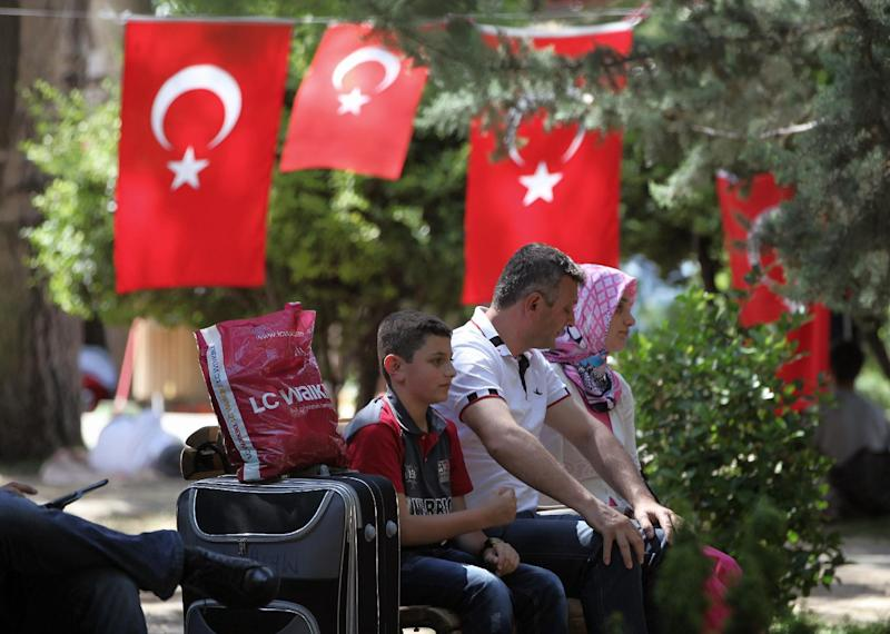 People rest in Kugulu Park in Ankara, Turkey, Monday, June 24, 2013. After weeks of sometimes-violent confrontation with police, Turkish protesters have found a new form of resistance: standing still and silent and forums.(AP Photo/Burhan Ozbilici)
