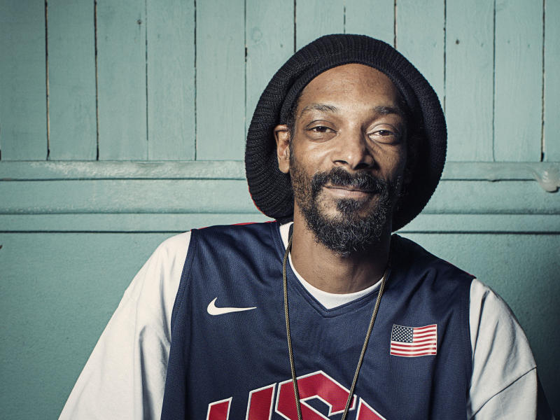 """FILE - This July 30, 2012 photo shows Snoop Dogg posing for a portrait at Miss Lily's in New York. The rapper smoked during the BMI's annual pre-Grammy Awards """"How I Wrote That Song"""" panel discussion at the Roxy in Los Angeles on Saturday, Feb. 9, 2013 on the eve of the Grammy Awards. (Photo by Victoria Will/Invision/AP, file)"""