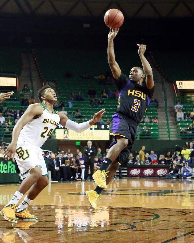 Hardin-Simmons John Barnes (3), right, shoots in front of Baylor's Ish Wainright (24) in the first half of an NCAA college basketball game Sunday, Dec. 1, 2013, in Waco, Texas. (AP Photo/The Waco Tribune-Herald, Jose Yau)