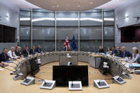 Britain's Brexit Secretary Stephen Barclay, second left, sits along with his team during a meeting with European Union chief Brexit negotiator Michel Barnier, second right, at the European Commission headquarters in Brussels, Friday, Sept. 20, 2019. (Kenzo Tribouillard/Pool via AP)