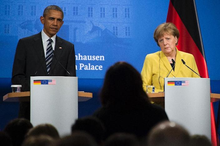 US President Barack Obama (L) was in Germany Monday for talks with Chancellor Angela Merkel and other European leaders expected to focus on the fight against the Islamic State group (AFP Photo/Jim Watson)