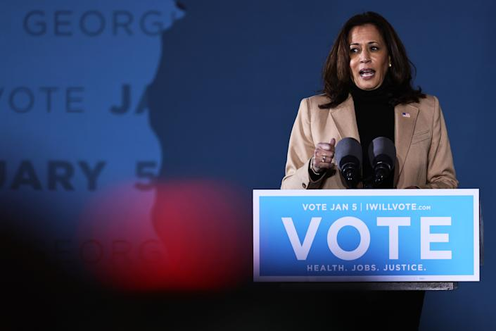 SAVANNAH, GEORGIA - JANUARY 03: Vice President-elect Kamala Harris speaks during a drive-in rally at Garden City Stadium on January 03, 2021 in Savannah, Georgia. Vice President-elect Kamala Harris joined Georgia Democratic Senate candidates Rev. Raphael Warnock and Jon Ossoff for a campaign event two days before the January 5th runoff election that has implications into which party controls the U.S. Senate. According to AJC, 3 million people have already casted their votes ahead of Tuesday's election.  (Photo by Michael M. Santiago/Getty Images)