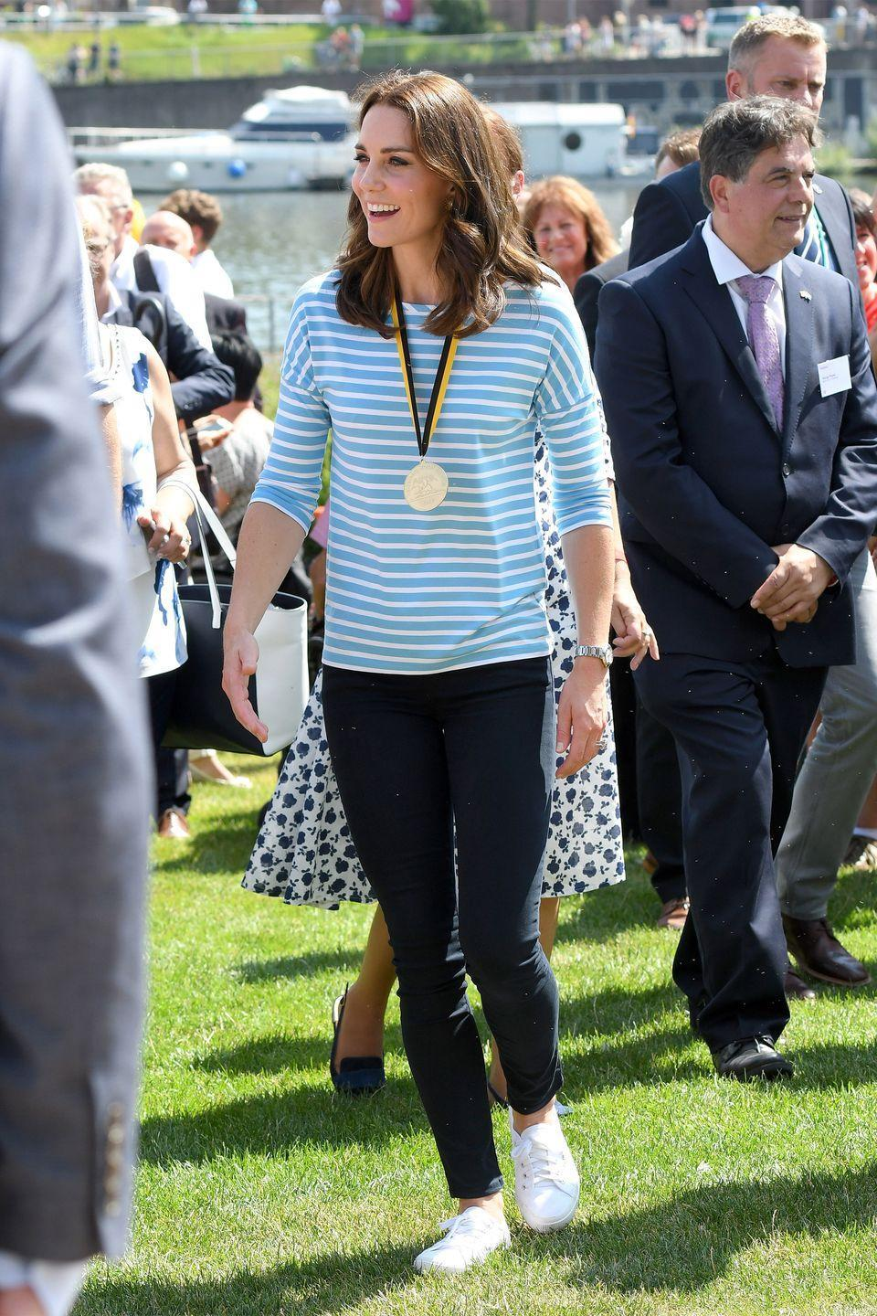 <p>In a striped Hugo Boss blue shirt, leggings and white sneakers while out in Germany. </p>