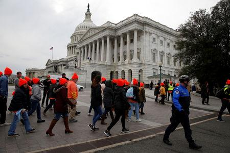 Protesters who call for an immigration bill addressing the so-called Dreamers, young adults who were brought to the United States as children, rally on Capitol Hill in Washington