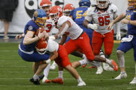Sam Houston State defenders tackle South South Dakota State place kicker Cole Frahm, front left, after a fumble on a field goal-attempt during the first half of the NCAA college FCS Football Championship in Frisco, Texas, Sunday, May 16, 2021. (AP Photo/Michael Ainsworth)