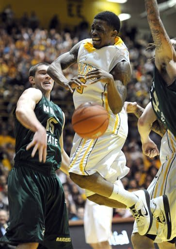 Valparaiso guard Erik Buggs, right, has his shot blocked by Wright State guard Kendall Griffin during second half action in a NCAA college basketball game for the Horizon League Championship Tuesday March 12, 2013 in Valparaiso, Ind. (AP Photo/Joe Raymond)