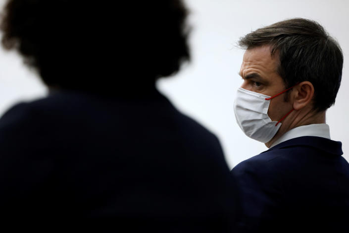 French Health Minister Olivier Veran attends a press conference in Paris, Thursday, Jan. 14, 2021. Trying to fend off the need for a third nationwide lockdown that would further dent Europe's second-largest economy and endanger more jobs, France is instead opting for creeping curfews. The prime minister announced Thursday an extension of the 6 p.m.-to-6 a.m. curfew to cover the whole country. (Thomas Coex, Pool Photo via AP)