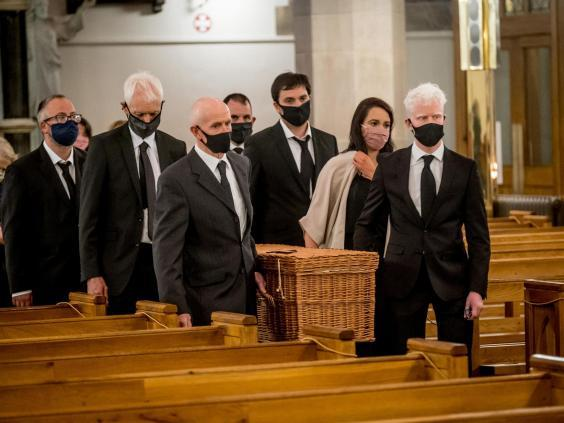 Members of the family carry John Hume's remains (Stephen Latimer/PA)