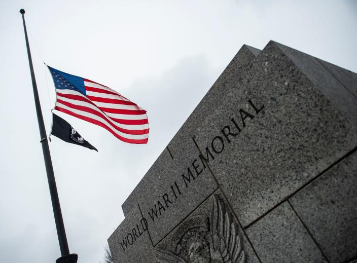 The U.S. flag flies at half-staff at the World War II Memorial in tribute to former President George H. W. Bush, on Dec. 1, in Washington, D.C. (Photo: Andrew Caballero-Reynolds/AFP/Getty Images)
