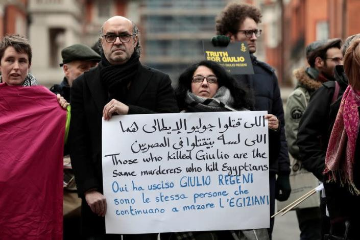 FILE PHOTO: Demonstrators from Amnesty International hold placards outside the Egyptian embassy in support of Giulio Regeni, who was found murdered in Cairo two years ago, in London