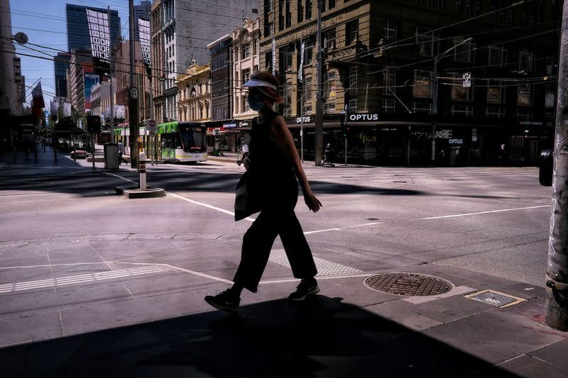 A woman walks on a street, amid a state-wide lockdown, in Melbourne city centre