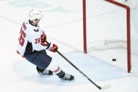 Washington Capitals center Nic Dowd (26) scores on an empty net during the third period of an NHL hockey game against the New Jersey Devils, Saturday, Feb. 27, 2021, in Newark, N.J. The Capitals won 5-2. (AP Photo/Mary Altaffer)