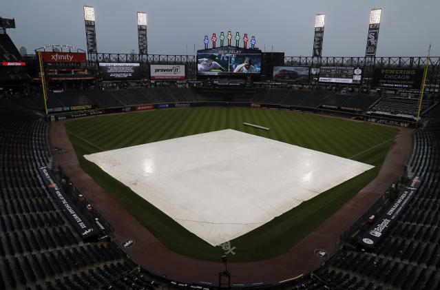 A tarp covers the infield during a rain delay during the fifth inning of a baseball game between the Toronto Blue Jays and the Chicago White Sox, in Chicago, Saturday, May 18, 2019. (AP Photo/Nam Y. Huh)