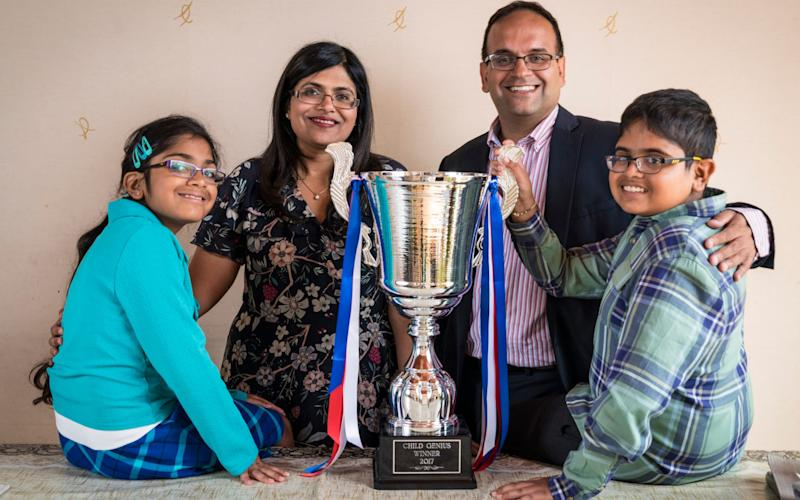 Rahul Doshi, the 12-year-old winner of Child Genius 2017, pictured with his mother Komal, father Minesh and sister, Ria - Andrew Crowley