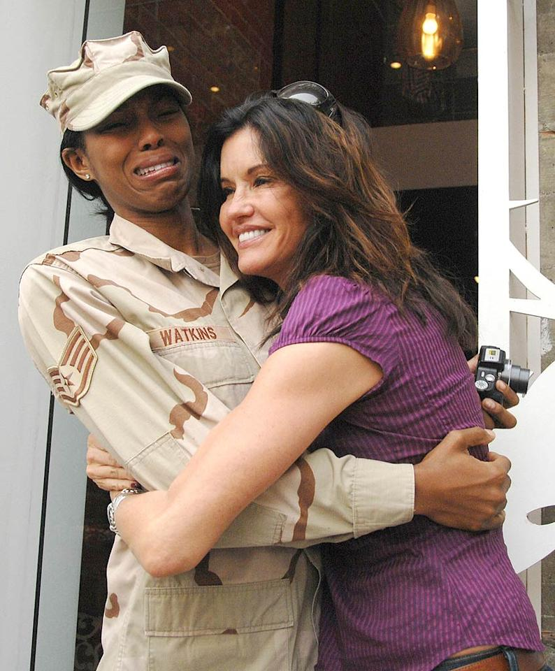 "No, Ms. Watkins wasn't crying because she had the life squeezed out of her; she got emotional when Janice professed her admiration for the troops. London Ent/<a href=""http://www.splashnewsonline.com"" target=""new"">Splash News</a> - November 11, 2009"