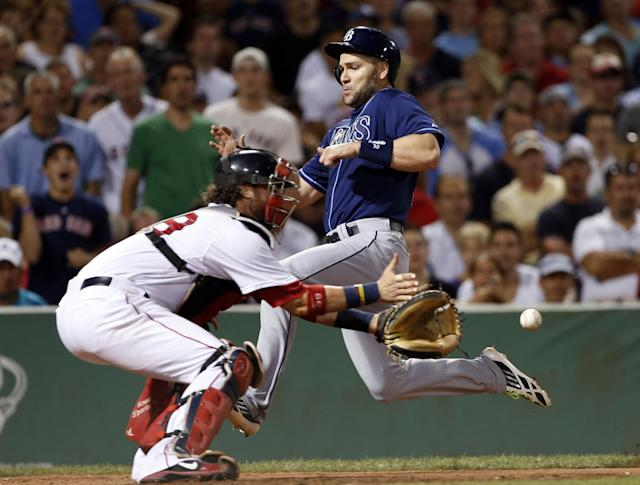 Tampa Bay Rays' Luke Scott beats the throw into Boston Red Sox catcher Jarrod Saltalamacchia as he scores on a single by James Loney during the eighth inning of a baseball game at Fenway Park in Boston Wednesday, July 24, 2013. (AP Photo/Elise Amendola)