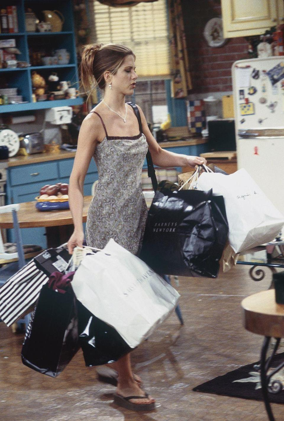 """<p>Was this taken in 2000 or in 2020? It's hard to tell, because Rachel's entire look – from her slip dress to her flip flops – is trending hard right now. </p><p><strong>What you'll need:</strong> <em>Wild Night Slip Dress, $104.90, Good American</em></p><p><a class=""""link rapid-noclick-resp"""" href=""""https://go.redirectingat.com?id=74968X1596630&url=https%3A%2F%2Fwww.goodamerican.com%2Fproducts%2Fwild-night-slip-dress-jungle001%3F_pos%3D2%26_sid%3D29aabd5f1%26_ss%3Dr&sref=https%3A%2F%2Fwww.redbookmag.com%2Ffashion%2Fg34220685%2Frachel-green-outfits-friends%2F"""" rel=""""nofollow noopener"""" target=""""_blank"""" data-ylk=""""slk:SHOP NOW"""">SHOP NOW</a></p>"""