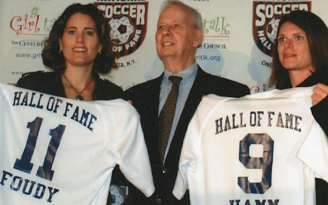 <span>George Brown, the former National Soccer Hall of Fame president, with Julie Foudy and Mia Hamm in February 2007</span>