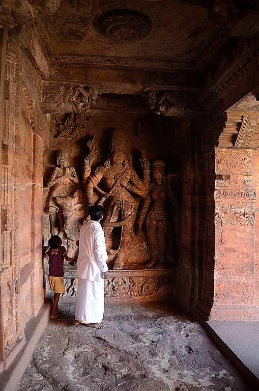 The first cave is dedicated to Shiva and the pantheon of Gods from Ganesha to Karthikeya, and you are greeted by reliefs and carvings on the ceilings. A sculpture of Shiva with 18 arms in different dance poses takes your breath away. The guide says it probably depicts an early interpretation of Nataraja – Shiva the cosmic dancer.
